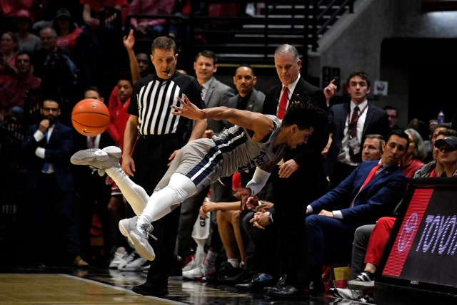 Jan 18, 2020; San Diego, California, USA; Nevada Wolf Pack guard Jazz Johnson (22) dives for a loose ball against the San Diego State Aztecs during the first half at Viejas Arena. Mandatory Credit: Kirby Lee-USA TODAY Sports