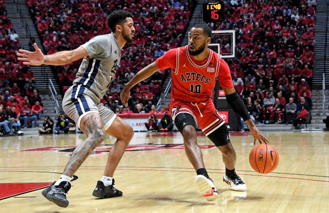 Jan 18, 2020; San Diego, California, USA; San Diego State Aztecs guard KJ Feagin (10) drives against Nevada Wolf Pack guard Jalen Harris (2) during the first half at Viejas Arena. Mandatory Credit: Kirby Lee-USA TODAY Sports