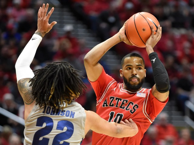 San Diego State guard KJ Feagin (10) looks to pass around Nevada guard Jazz Johnson (22) during the first half of an NCAA college basketball game Saturday, Jan. 18, 2020, in San Diego. (AP Photo/Denis Poroy)