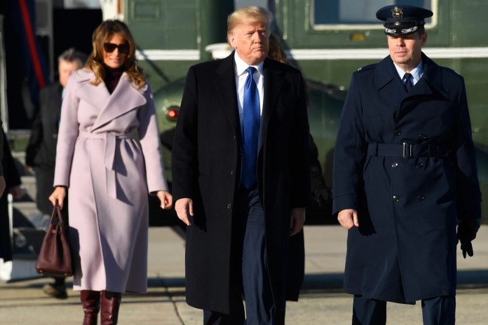 President Donald Trump and first lady Melania Trump head for Air Force One at Andrews Air Force Base in Md., on Jan. 17, 2020, on their way to a weekend at Mar-a-Lago in Florida.