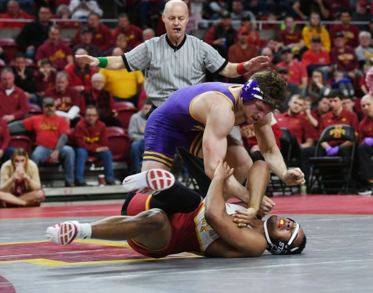 Northern Iowa's Taylor Lujan takes down Iowa State's Marcus Coleman during the Cyclones' 18-16 win over the Panthers in February. Both were NCAA qualifiers at 184 pounds.