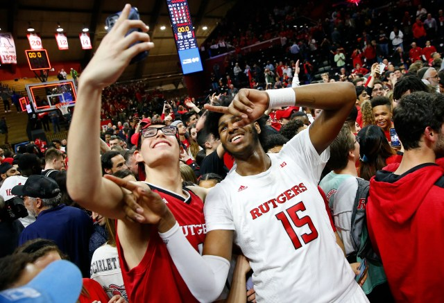 Rutgers Scarlet Knights center Myles Johnson (15) celebrates with fans after defeating the Maryland Terrapins at Rutgers Athletic Center (RAC).