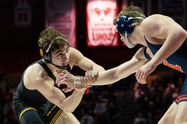 Iowa's Austin DeSanto wrestles Illinois's Travis Piotrowski at the Big 10 Wrestling Championships at Rutgers Athletic Center on Sunday, March 8, 2020.