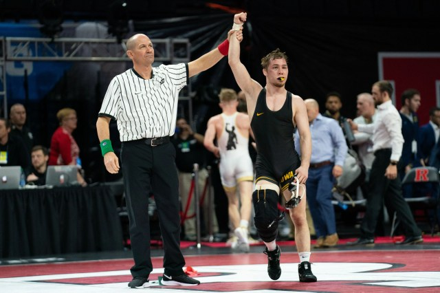 Iowa's Spencer Lee defeats Purdue's Devin Schroder 16-2 to win his first Big 10 title.