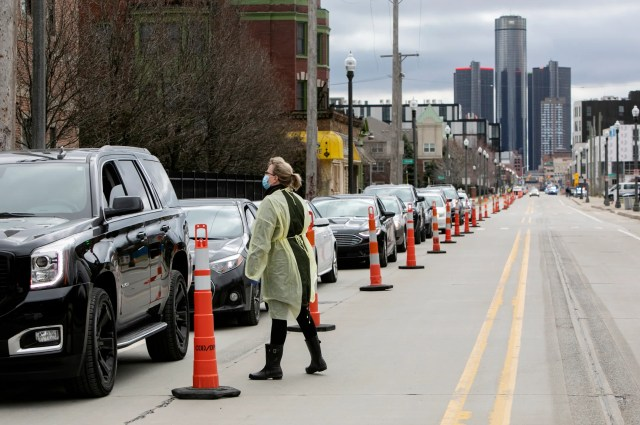 A Wayne State medical professional particiaptes in the Detroit Regional COVID-19 Drive Thru Testing Program as she prescreens a first responder Friday, March, 20, 2020 before they are tested for COVID-19. Wayne State with the help of the DPD funneled traffic one way down Brush Street from the I-75 service drive to tents set up in a lot at 2900 Brush Street in Detroit.