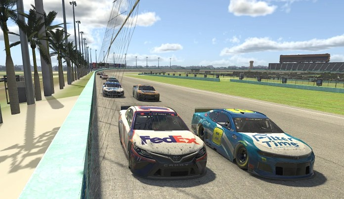 In this computer generated image in the game, Denny Hamlin, left, races with Dale Earnhardt Jr. (8) during the eNASCAR iRacing Pro Invitational Series Dixie Vodka 150 at Virtual Homestead-Miami Speedway.
