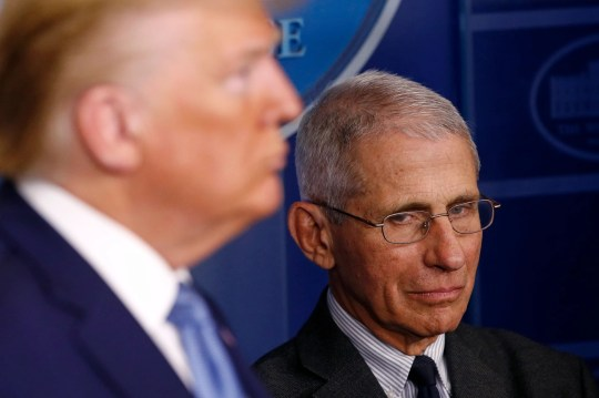 Director of the National Institute of Allergy and Infectious Diseases Dr. Anthony Fauci, right, and President Donald Trump listen as Vice President Mike Pence speaks during a coronavirus task force briefing at the White House, March 21, 2020, in Washington.