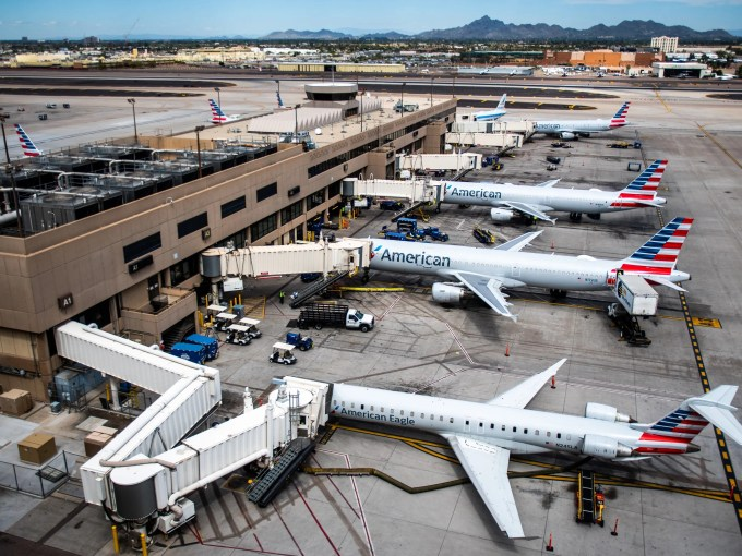 American Airlines planes fill Terminal 4 at Phoenix Sky Harbor International Airport on March 26, 2020.