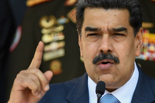 FILE - In this March 12, 2020, file photo, Venezuelan President Nicolas Maduro speaks at a press conference at the Miraflores Presidential Palace in Caracas, Venezuela. The Trump administration will announce Thursday, March 26, 2020, indictments against Maduro and members of his inner circle for effectively converting Venezuela's state into a criminal enterprise at the service of drug traffickers and terrorist groups, according to multiple people familiar with the situation. (AP Photo/Matias Delacroix, File) ORG XMIT: XMD501