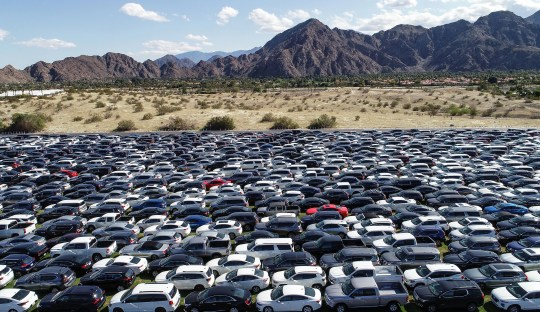 Thousands of cars that would normally be used by the people who flock to the Coachella Valley during the height of tourism season sit empty at the Indian Wells Tennis Garden as the coronavirus disrupts normality, March 25, 2020.