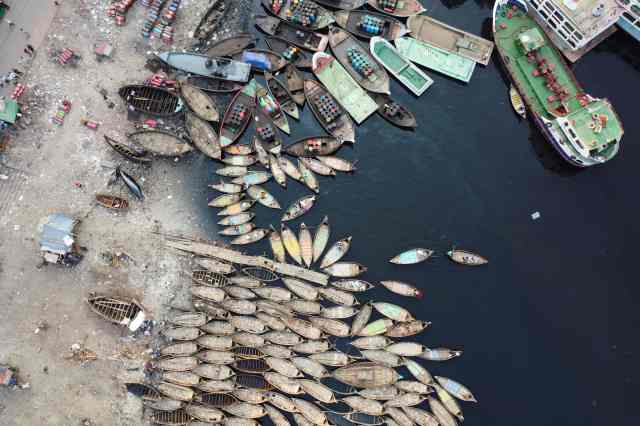 The aerial picture shows boatmen waiting for passengers docked on the bank of a river during a government-imposed lockdown as a preventive measure against the COVID-19 coronavirus in Dhaka , Bangladesh on March 28, 2020.
