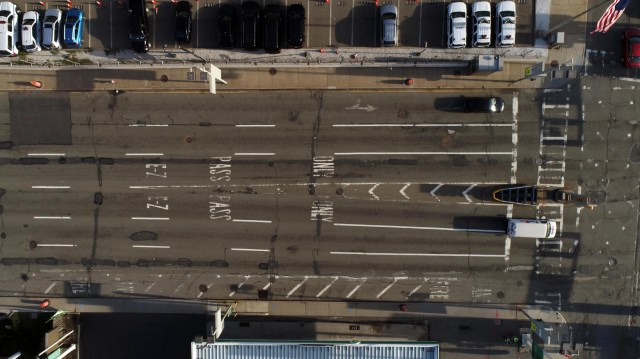 A drone image shows a nearly empty EZPass lanes at the entrance of the Holland Tunnel around 8:15am on April 1, 2020.