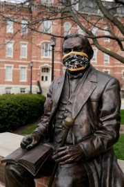 Statue of John Purdue, founder of Purdue University, wearing a mask on April 7 in West Lafayette, Indiana.