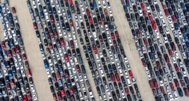 People wait in their cars Thursday, April 9, 2020, at Traders Village for the San Antonio Food Bank to begin food distribution. The need for emergency food aid has exploded in recent weeks due to the coronavirus epidemic.