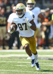 22 September 2018; Winston-Salem, NC, USA; Notre Dame Fighting wide Irish receiver Michael Young (87) runs after capturing in the second quarter against Wake Forest Demon Deacons at BB&T Field.