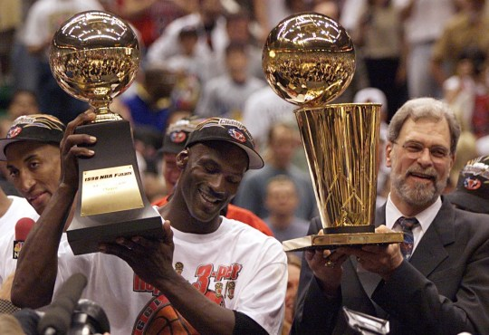 Michael Jordan and Phil Jackson celebrate after finishing Jazz to win the 1998 championship.