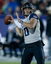 Utah state quarterback Jordan Love appears to pass during the first half of the NCAA Collegiate football game Frisco Bowl against Kent State Friday December 20, 2019 in Frisco, Texas.