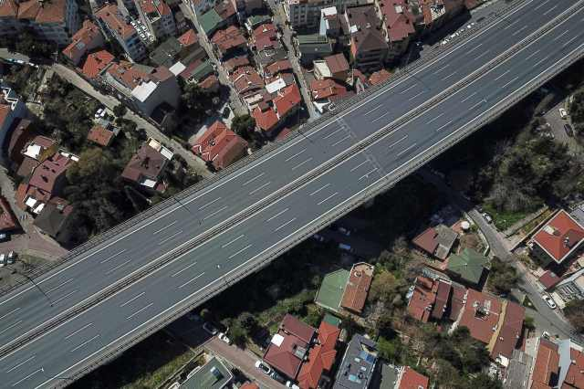 This aerial picture shows a road leading to the July 15 Martyrs' Bridge, known as the Bosphorus Bridge in Istanbul on April 18, 2020, as Turkish government announced a two-day curfew to prevent the spread of the novel coronavirus COVID-19.