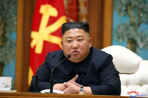 In this undated file photo provided by the North Korean government on Saturday, April 11, 2020, North Korean leader Kim Jong Un attends a politburo meeting of the ruling Workers' Party of Korea in Pyongyang.