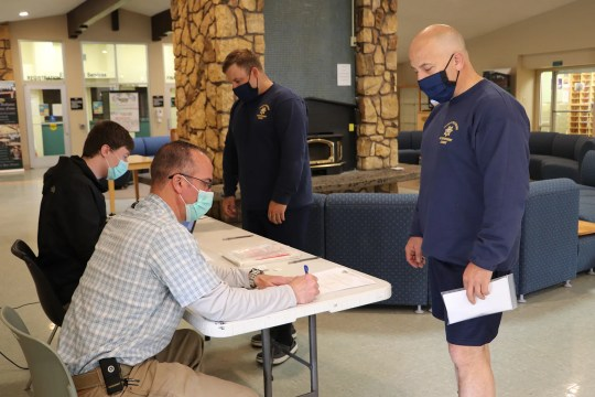 Students enrolled in the Siskiyou College law enforcement program register with Siskiyou County public health workers for a coronavirus test on Wednesday, May 13, 2020. Students, faculty and staff tests on the campus were part of the school plan to resume face to face. -courses and training on the College's law enforcement, firefighter and paramedic programs.