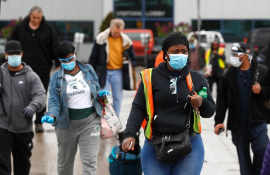 Workers leave after their shift at Fiat Chrysler's Warren Truck Plant in May on their first day back at work after the coronavirus shutdown.