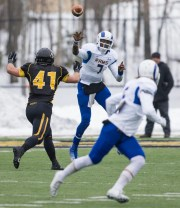 Kyle Washington from Angelo State qualified for the Pecarai Pecarai while under pressure during the NCAA Division II first round playoff match against Michigan Tech in Houghton, Michigan, on November 22, 2014.