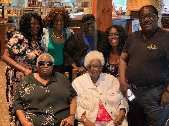 The Hatch family goes out to eat to celebrate Rhoda's 72nd birthday in Chicago, Ill. in 2018. Top row (from left to right) : Jennie Hatch, Priscilla Hatch (Marshall's wife), Anna Hatch, Josephine Hatch, Marshall Hatch Sr. Bottom row (left to right): Joan Hatch, Rhoda Hatch.