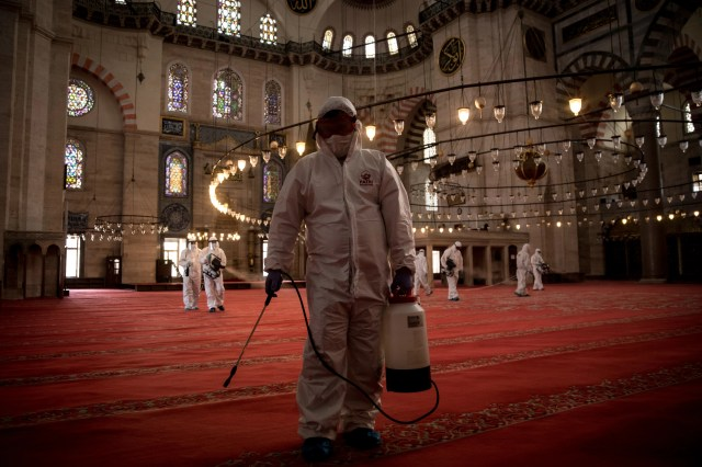 Employees from Fatih Municipality disinfect Suleymaniye Mosque on the last day of the Muslim holiday of Eid al-Fitr during a four-day lockdown to help stop the spread of the coronavirus on May 26, 2020 in Istanbul, Turkey.