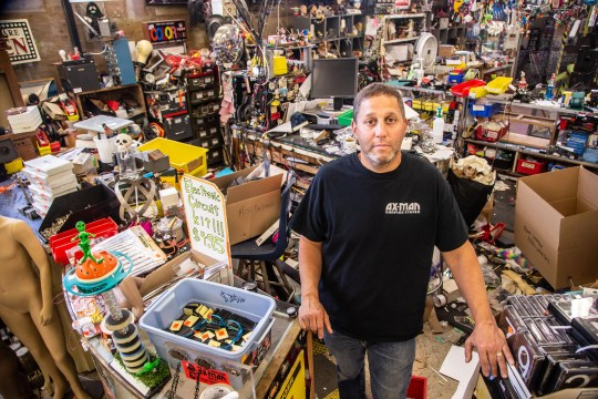 Jim Segal, Owner of Ax-Man Surplus in St. Paul stands behind the counter of his St. Paul store Saturday, May 30, 2020. Protestors broke into his store looting and destroying goods while Segal was trapped in a back room.