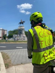 """James Kelley, 29, of Richmond, Virginia, attends a protest at the Robert E. Lee statue wearing a vest marked with the words """"Justice for George Floyd"""""""