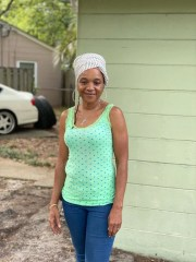 Elizabeth Anderson standing outside the house in Charleston, South Carolina which she could lose due to foreclosure.