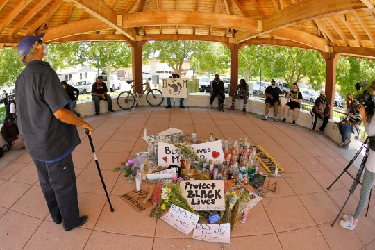 People gather at a memorial at the site where Robert Fuller was found hanged, Monday, June 15, 2020, in Palmdale, Calif.