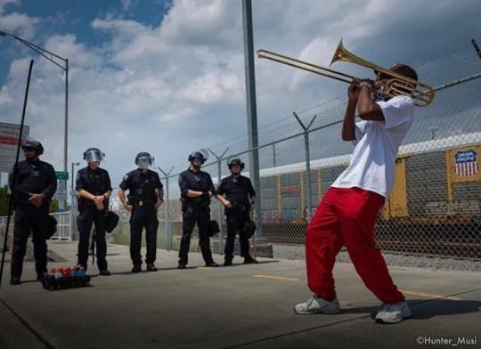 Black Lives Matter activist Marcus McDonald plays his trombone at a recent protest in Charleston, South Carolina.