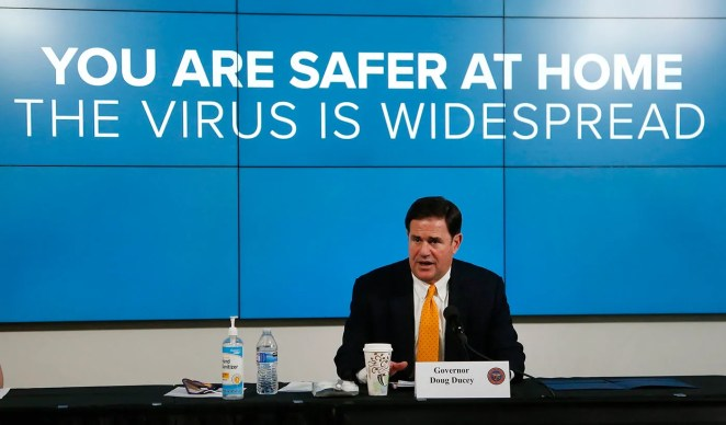 Arizona Gov. Doug Ducey speaks about the latest coronavirus data at a news conference on June 25, 2020, in Phoenix.