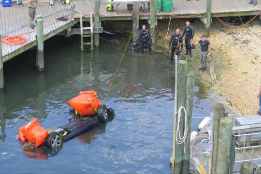 An elderly woman was pronounced dead at the hospital after police found her black SUV in the Manasquan River at Bogans Basin Deep Sea Fishing Center Sunday night.