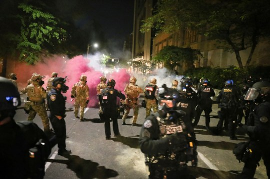 Police respond to protesters during a demonstration,  Friday, July 17, 2020 in Portland, Ore.