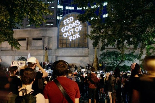 Protesters projected words on the front of the Multnomah County Justice Center July 20 in Portland, Ore.
