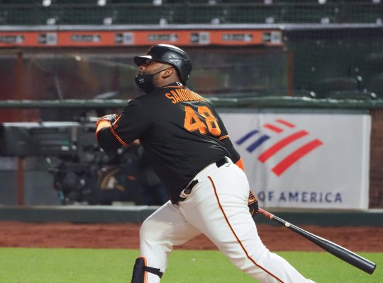 Pablo Sandoval hits a double against the Athletics during the spring game.