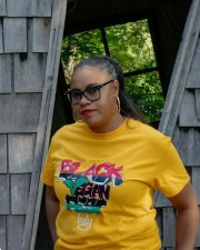 Black Vegan Fest Indy founder Quiana Quarles poses with a festival T-shirt. The festival will take place in an online format this Saturday.