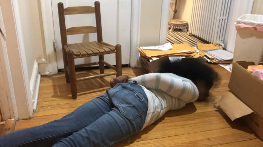 Shirley Profit demonstrates a restraint she experienced on the floor when she was a student at High Road schools in Connecticut. Representatives from the company that runs High Road said the use of face-down floor restraints was very rare, and the schools stopped using them after July 2015, when the state banned the practice.