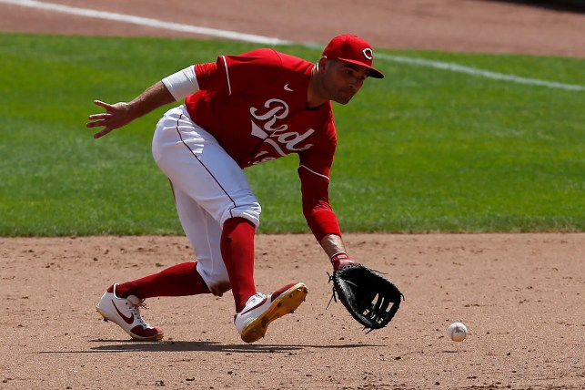 Joey Votto placed on the injured list after reporting COVID-19 symptoms