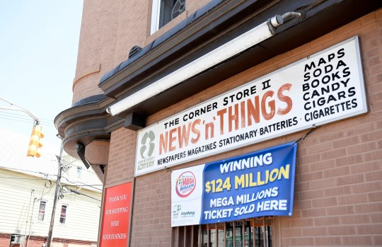 James Carey, executive director of the New Jersey State Lottery, holds a press conference outside Corner Store II, News N Things in Bayonne, where the winning $ 124 million ticket was sold on Monday July 27, 2020.