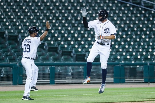 Tigers Center Fielder JaCoby Jones, Ramon Santiago, third base coach after completing a home run against the Royals in the seventh inning of the Tigers' 5-4 win at Comerica Park on Wednesday, July 29, 2020.
