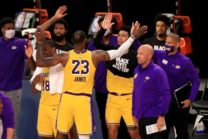 July 30: LeBron James and the Lakers celebrates after edging the Clippers in their opening game of the season restart.