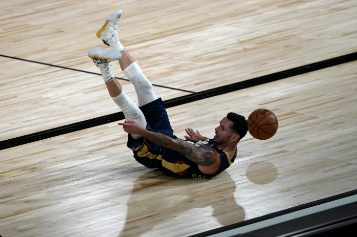 July 30: Pelicans guard J.J. Redick hits the deck against the Jazz.