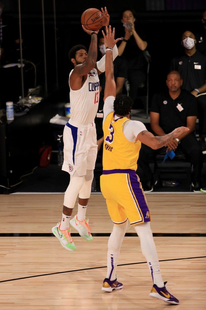 July 30: Clippers forward Paul George (13) shoots over Lakers defender Anthony Davis (3).