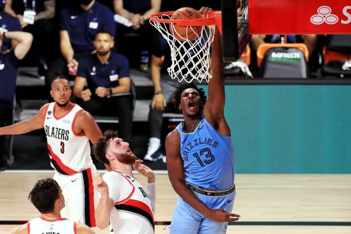 July 31: Grizzlies forward Jaren Jackson Jr. throws down the one-handed slam against Blazers defender Jusuf Nurkic.