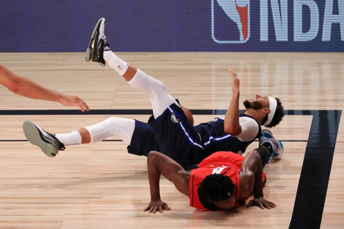 July 31: Meavericks guard Seth Curry and Rockets guard Danuel House Jr. hit the deck while scrambling for a loose ball.