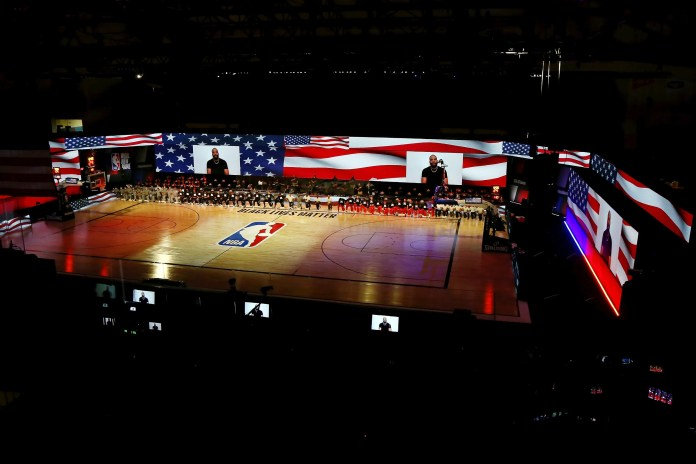 Aug. 2: The Wizards and Nets open Day 4 of seeding games by kneeling during the national anthem.