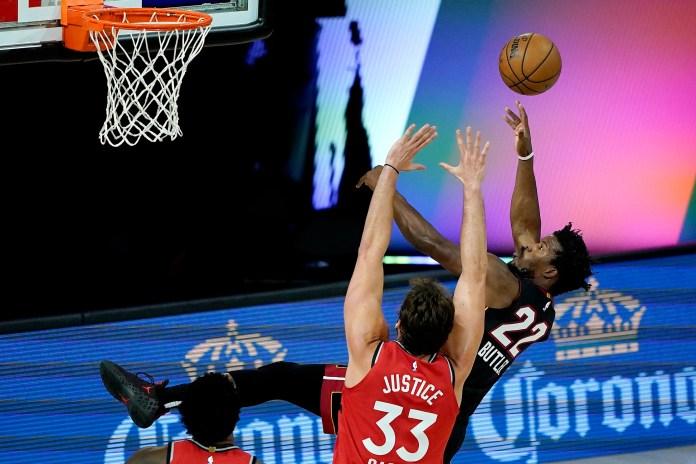 Aug. 3: Heat forward Jimmy Butler (22) puts up the off-balance shot against Raptors center Marc Gasol (33).